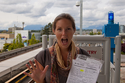 Waiting for a train back into the city, we're very excited to have all our papers signed off - now the bikes can be released from customs!