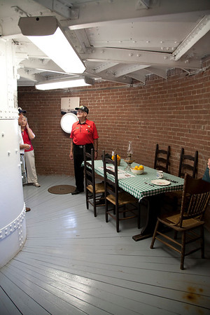 The lower floors of the lighthouse are surprisingly roomy. This one give a glimmer of lighthouse life with its setting of a dining table.