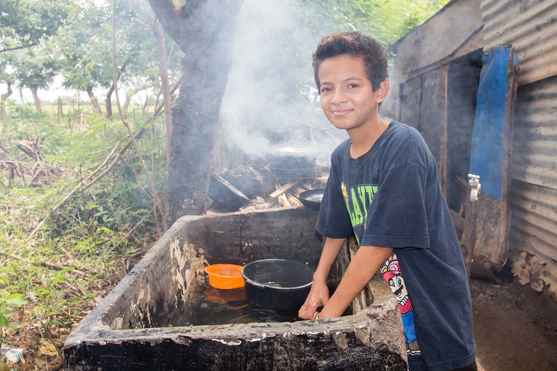 Erlin attends school in the afternoon and in the morning he helps his famiy  to do some household chores.