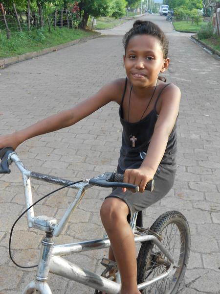 Yolanda on her bike in the barrio.