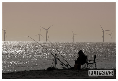 Sea fishing off the beach at Skegness, UK