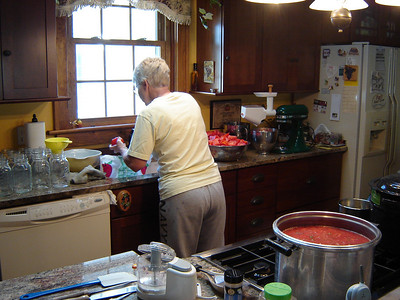 Kay spent three hours cutting up Tomatoes to put into the second pot of Sauce.
