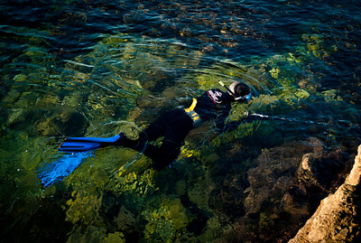 Man hunting fish in the waters of Cap d'Antibes