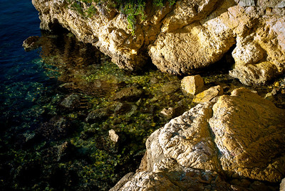 Rock and water at sunset in Cap d'Antibes