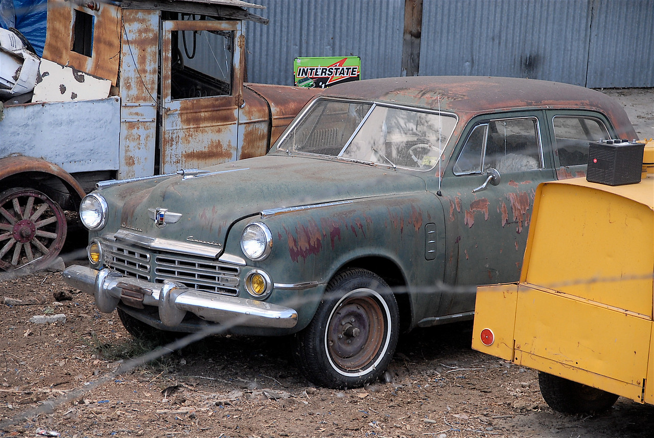 An Old Studebaker sitting in his yard
