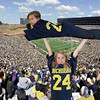 "background image by AndrewHorne  from  <a href=""http://commons.wikimedia.org/wiki/Category"">http://commons.wikimedia.org/wiki/Category</a>:Michigan_Stadium#mediaviewer/File:Michigan_Stadium_2011.jpg (I added blur)"
