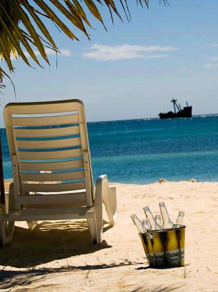Corona and a beach. Roatan Honduras