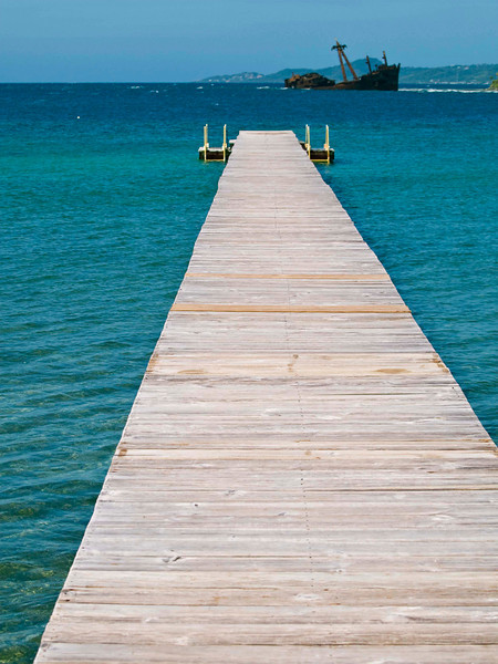 Dock into the blue waters, Roatan Honduras