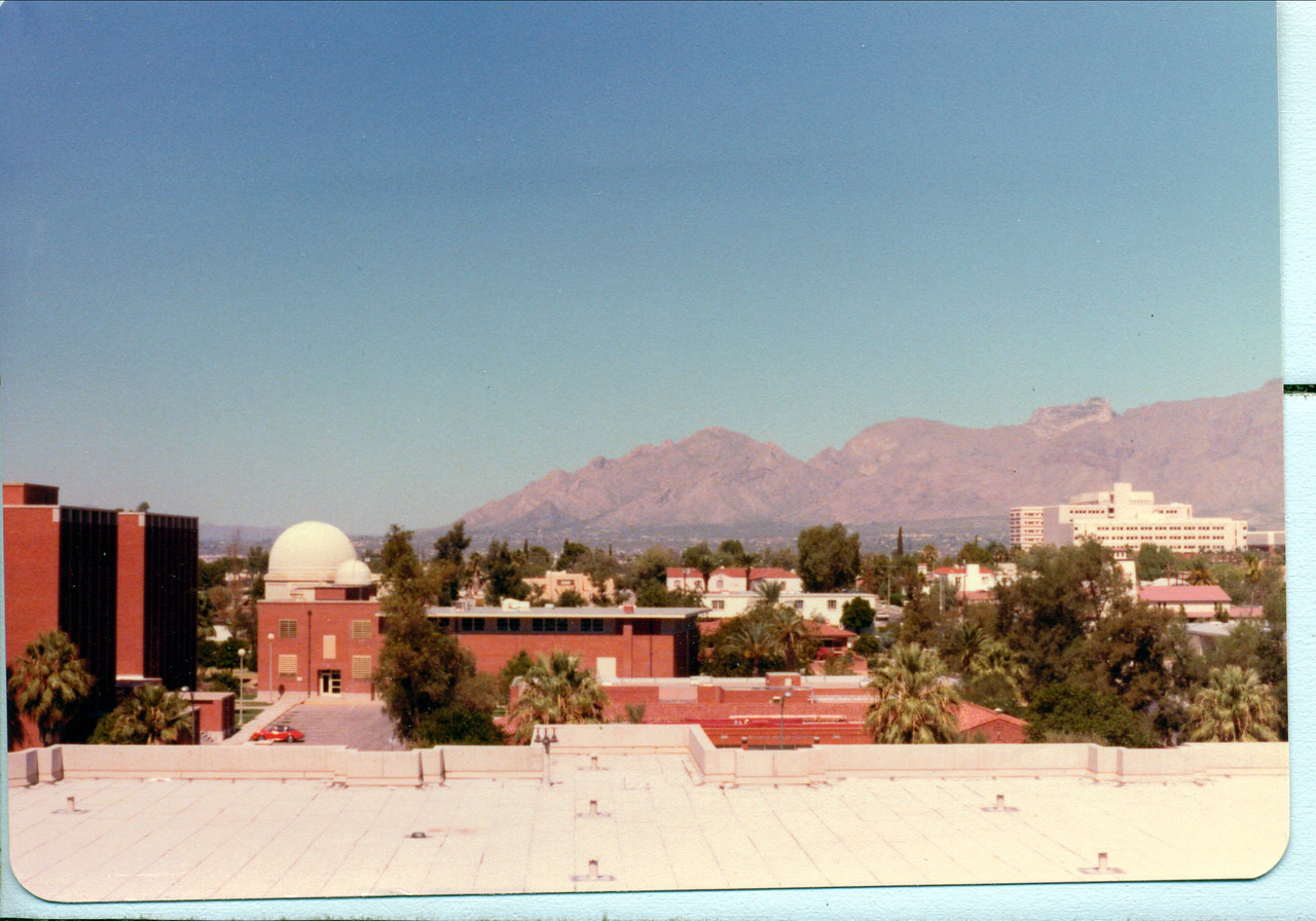 I snapped this photo at some point during the day from a building near the domes of Steward Observatory looking towards  Dr. Sagan's car.  If  you look in the parking lot you can see his Porsche in this image. (Click on the above image to enlarge.)
