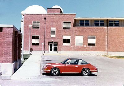Here's something you probably won't see anywhere else. This is famous astronomer Carl Sagan's red Porsche Targa. I took this picture in the fall of 1977 while attending the University of Arizona. I was working at Steward Observatory and we kept seeing Dr. Sagan run to his Porsche, perhaps due to a tight schedule not having time to stop and chat with students. I just happen to have my trusty Minolta SRT 101 camera there that day and grabbed this shot ! Carl Sagan was so pestered by others he supposedly hired a body guard some years later ! This and the other image I shot are the only photos I know of his actual car !!