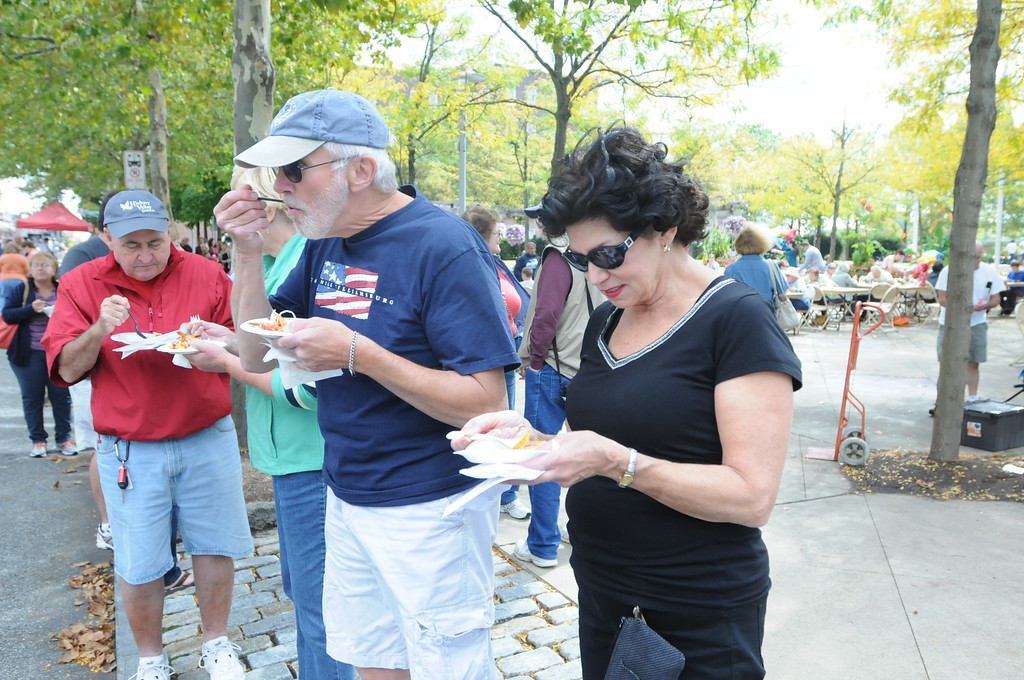 . Ginny and Gene Takach along with Dave and Linda Reed were at the Carousel of Flavor to taste samples prepared by area restaurants and catering companies Sunday in downtown Pottstown along High St. Photo by John Strickler/The Mercury