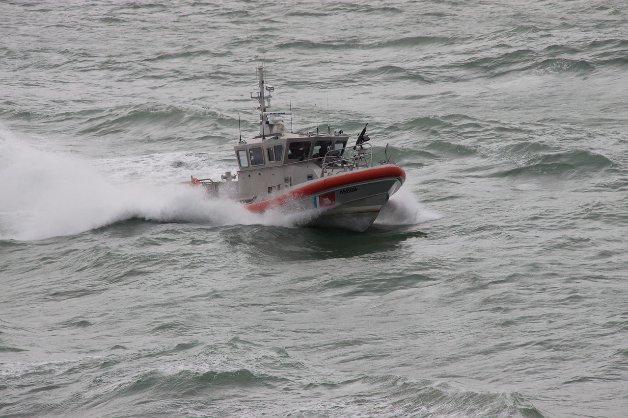 Coast Guard accompanying the Enchantment with waters getting rougher.