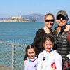 The family with Alcatraz in the background.