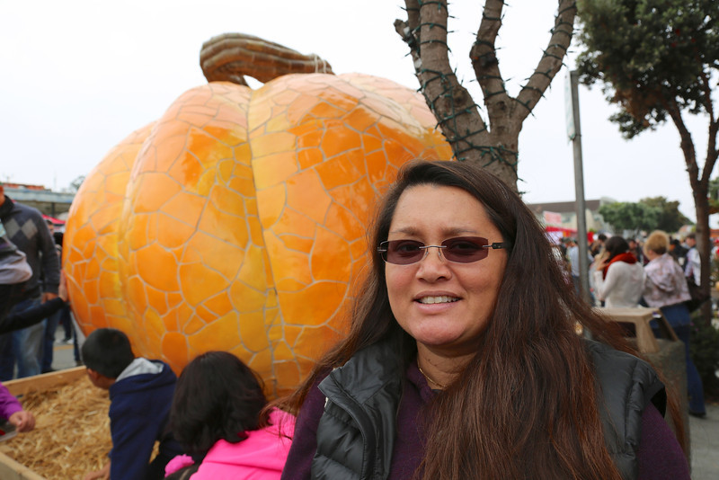Timber with a giant ceramic pumpkin.