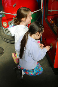 Ava and Bell Bell playing a game at the arcade near Fisherman's Wharf in San Francisco, California.