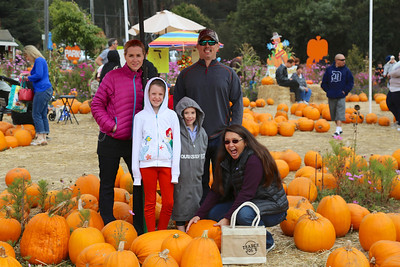 The family at the pumpkin patch.
