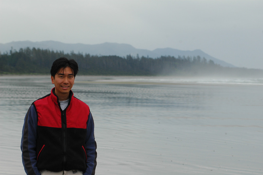 An asian man standing at the ocean - Stock Photo by Nature Photographer Christina Craft