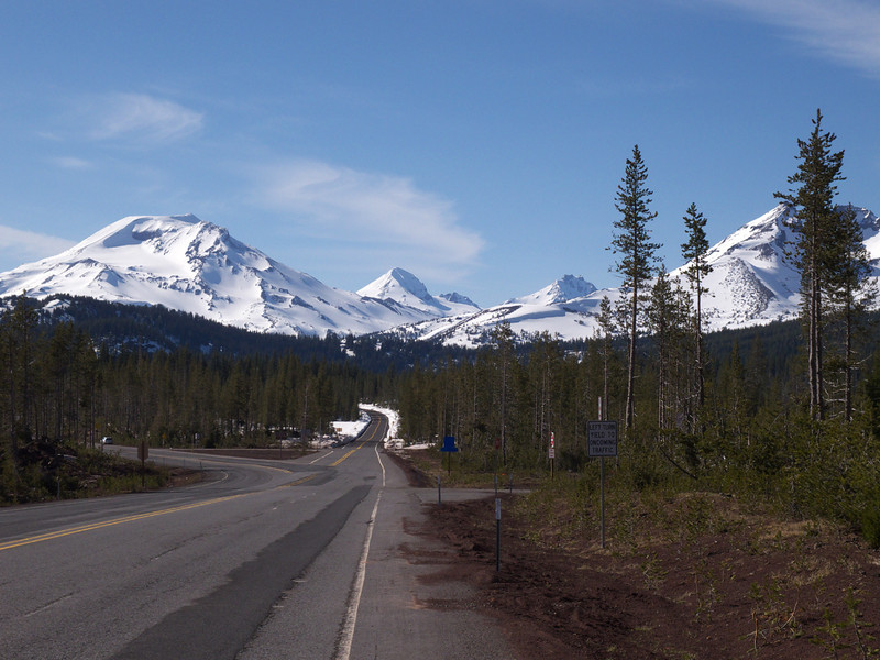 view of South, Middle & North Sisters and Broken Top from Century Drive