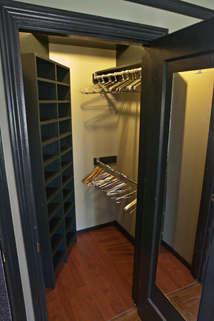 Walk-in closet with lots of shoe storage and hanging space.