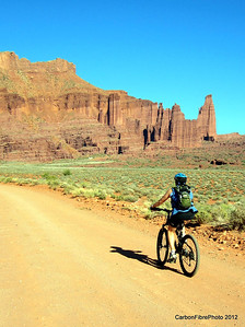 Julie on the way to the Fisher Towers, which sits below Top of the World, our favorite hike and bike in the Moab area.  What a view!