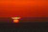 Puesta de sol un día de bruma en La Barrosa