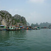 "Floating aquaculture village in Halong Bay.  They have ""pens"" of fish."