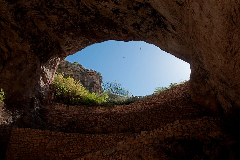 This is the natural entrance to the Caverns.  Those are birds in the sky. They are swallows that nest in the cave entrance. The bats haven't arrived from Mexico yet.  We took this shot after the visitor center had closed the gate.  There were no people coming down the trail.
