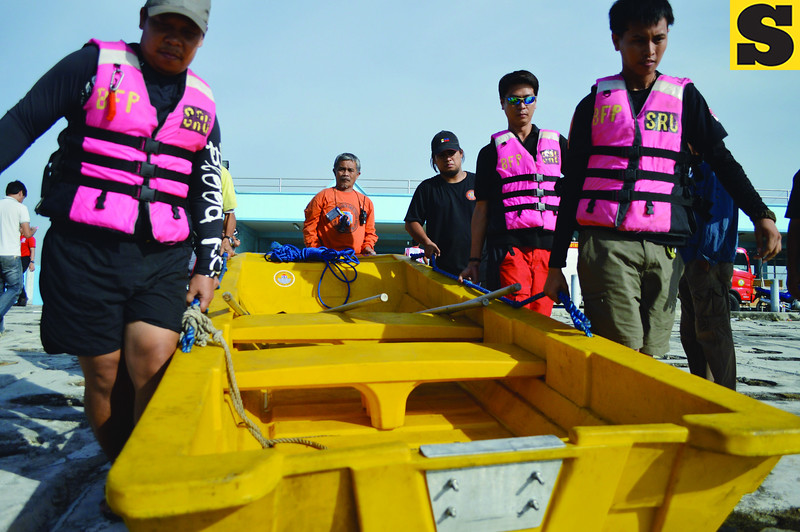 Rescuers with their emergency boat