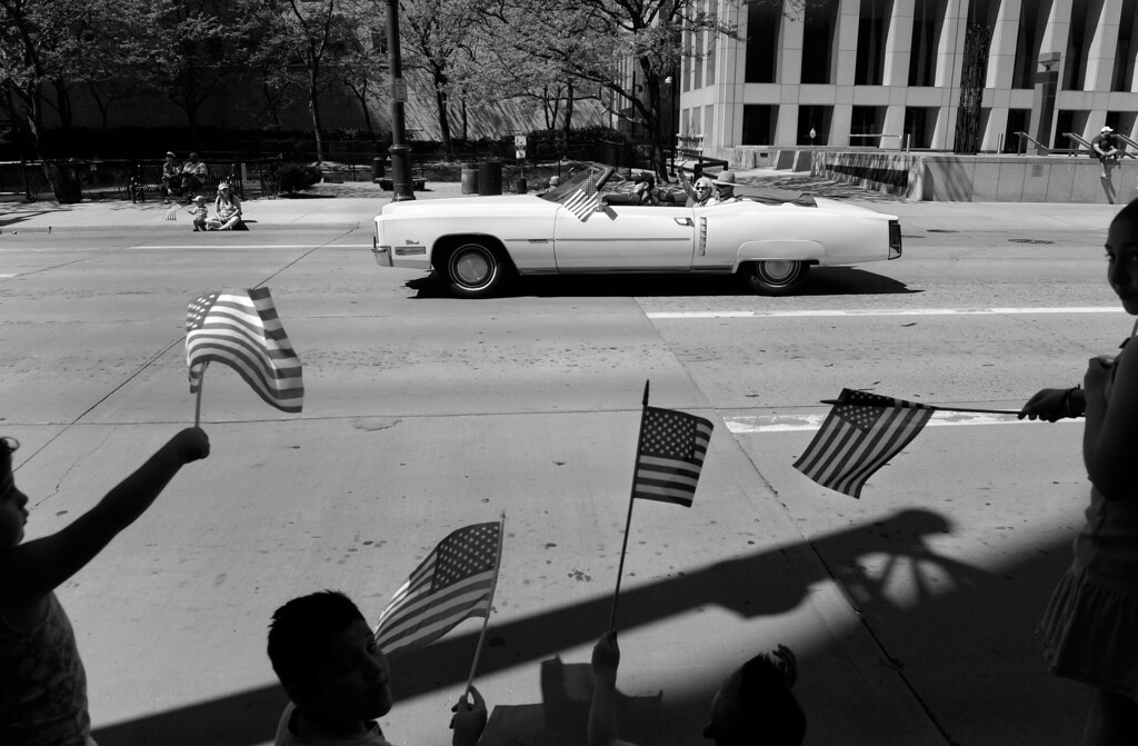 ". Cecil rides with Carl in a 1972 Cadillac Eldorado during the Memorial Day parade in Denver. The couple was invited to join the American Veterans for Equal Rights Colorado GLBT Color Guard, a group made of both gay veterans and gay service men and women who are active duty. Both Cecil and Carl served in the United States Air Force at a time when being gay was reason for dismissal. Cecil was a First Lieutenant in the Air Police, and Carl was an Airman First Class and a nuclear weapons instructor. ""You just didn\'t do [or say] anything,\"" Cecil said. \""What\'s worse than being kicked out of the military would be going home and telling your family why...  we just didn\'t talk about it.\""  (Photo By Craig F. Walker/The Denver Post)"