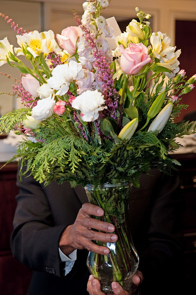 Delton hides his tears behind Rick's flowers.