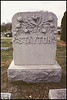 The Stayton tombstone is adorned with poppies which symbolize eternal sleep.  Lee's Summit City Cemetery, Lee's Summit, Missouri, Nov. 17, 2001