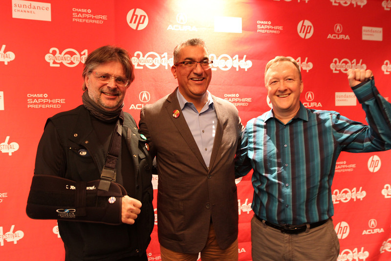 """Cinematographers James Chressanthis, Director Richard Ray Perez, and Gary Thompson (Holding a """"Huelga"""" sign) pose for a photo before the world premier of Cesar's Last Fast."""