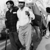 Archival photo of Cesar Chavez marching as part of the famous farm worker's strike.
