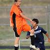 Kolby Whisler heads the ball