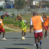 Champion's League tournament at VPUU field in Harare Peace Park in Khayelitsha, April 2014.  (After the official Champs League pilot ended, 4 Champs League Coaches continued the league with former participants and other young men in the community.)