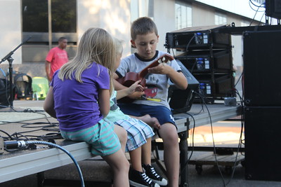 Folk duo Channing and Quinn perform before an audience of local residents as part of Max and Emily's Summer Concert Series, Thursday, July 30 on Broadway Street in Downtown Mt. Pleasant.