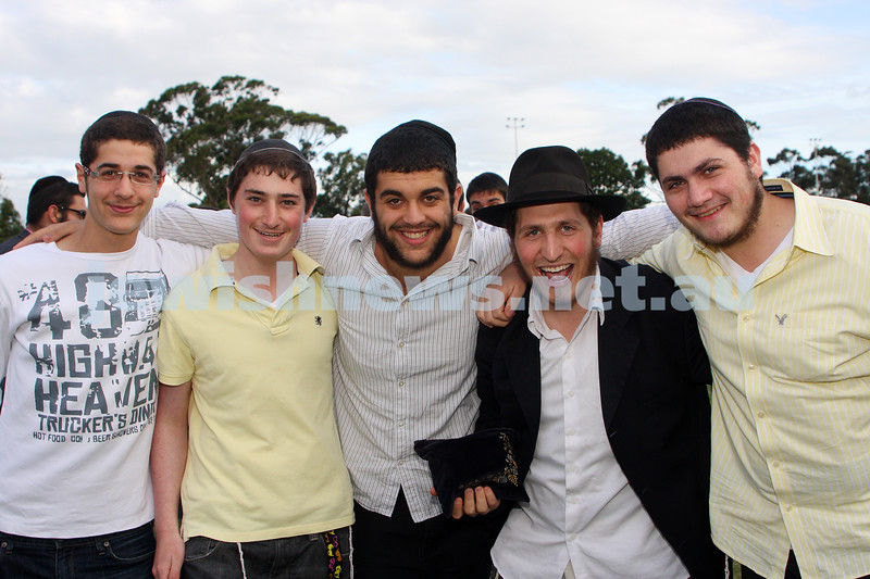 Chanukah in Caulfield Park 2009. From left: Eli Tatarka, Yossi Mochkin, Mendy Ash, Gabi Geula, Richard Diament. photo: Peter Haskin