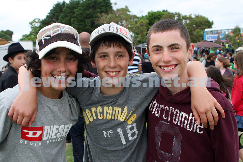 Chanukah in Caulfield Park 2009. From left: Ethan Kemelman, Benji Weinmann, David Bookman. photo: Peter Haskin