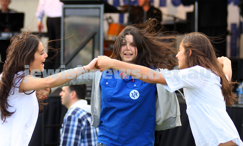 Chanukah in Caulfield Park 2009. Girls dancing. From left: Lauren Ross, Sophie Zilberman, Ashleigh De Winter. photo: Peter Haskin