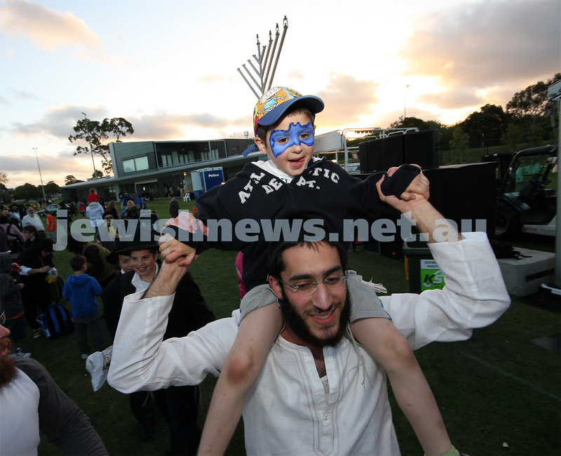 13/12/09. Chanukah in Caulfield Park 2009. Avi Kluwgant gets a shoulder ride. Photo: Peter Haskin