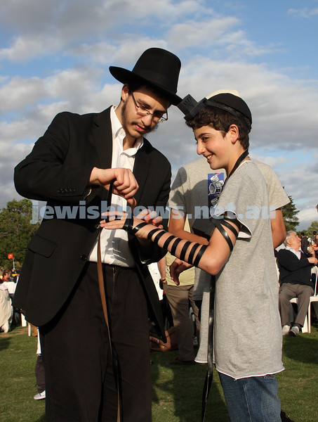Chanukah in Caulfield Park 2009. Yotam Baiazani putting on tephillin. photo: Peter Haskin