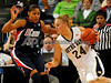 Choice 8 of 9<br /> <br /> FILE - In this March 1, 2010, file photo, Notre Dame guard Lindsay Schrader (24) drives against Connecticut guard Maya Moore during an NCAA college basketball game in South Bend, Ind. (AP Photo/Joe Raymond, File)