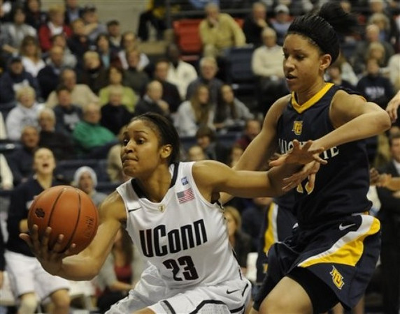 Choice 1 of 9<br /> <br /> Connecticut's Maya Moore (23) pulls in a loose ball past Marquette's Courtney Thomas in the second half of an NCAA college women's basketball game at Storrs, Conn., Thursday, Dec. 9, 2010. (AP Photo/Bob Child)