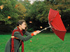 Choice 17 of 18 / Woman holding umbrella in wind, side view