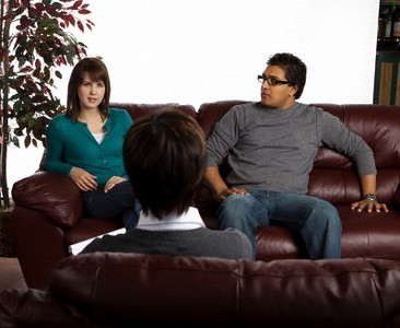 Couple in counseling --- Image by © Ron Nickel/Design Pics/Corbis