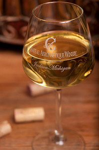 A white wine at the Chateau Aeronautique Winery in Jackson, MI on May 4, 2013.  Tasters get to keep their wine glasses.  (Photo by Mark Bialek)