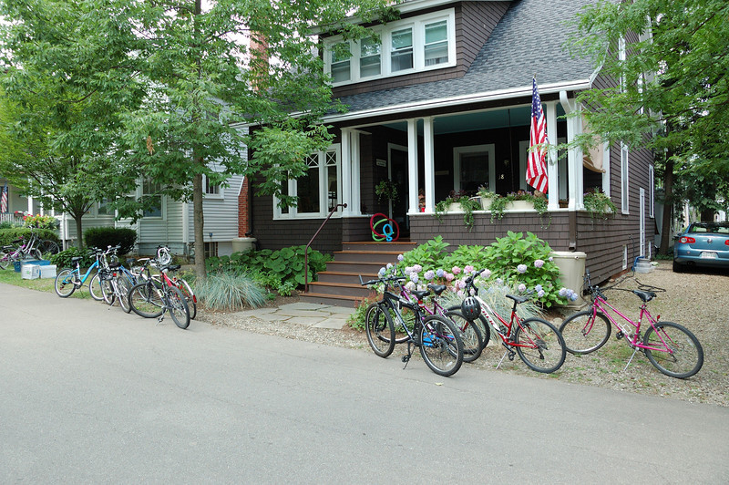 Summer 2010 at 38 Foster Ave.  Nate and his bunch are on the parch for lunch. Bicycles are obviously the mode of transportation here.