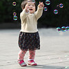 Girl Chasing Colorful Bubbles 女孩和泡泡