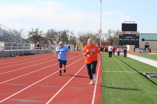 Tera Brown, left, and Cindy Laver compete in the 50-meter dash, female division. Laver went on to win first in the event.