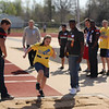 Teressa Baker, a fifth grader at Kansas Public Schools, takes a running leap into sand while competing in the running long jump event.